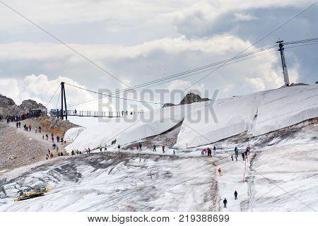 RAMSAU AM DACHSTEIN AUSTRIA - AUGUST 17: People hiking around Dachstein Hunerkogel mountain station on August 17 2017 in Ramsau am Dachstein Austria.