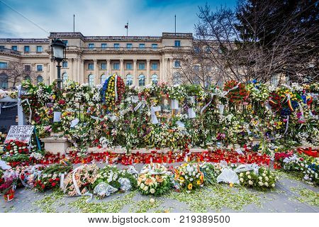 Bucharest Romania - December 15 2017: Candles in front of Carol Palace oposit the Art Institut Foundation with the occasion of Romanian King Mihai de Hohenzollern funeral