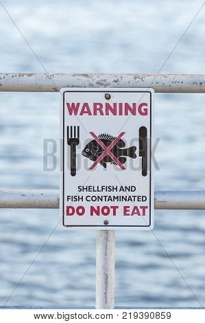 New Bedford Massachusetts USA - December 21 2017: Sign warning not to eat fish and shellfish from these waters