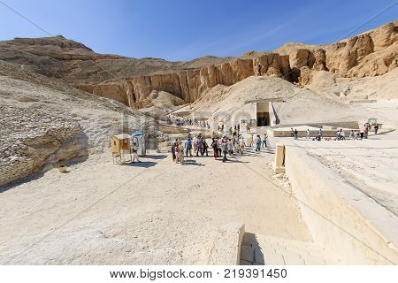 Luxor, Egypt - November 13. 2006: Tourists in the Valley of Kings near Luxor. Travel in Egypt, famous Egyptian landmarks. Archaeological research in the mountains of the Valley of the Kings in the ancient Egyptian capital of Thebes