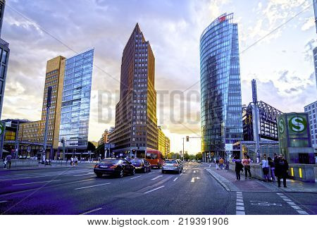 BERLIN GERMANY - AUGUST 28 2017; Street scenes including three new urban development ultra-modern architectural highrise buildings at Potsdamer Platz a modern city square