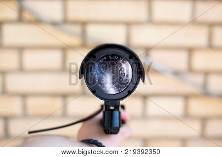 mah hand holding video security camera isolated