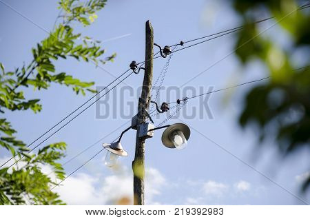 old wooden lamp post. electricity lamp post