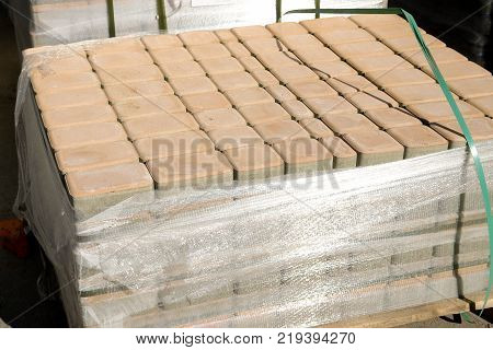 Pavement stones on market. Paving slabs store. Cobblestone on pallets