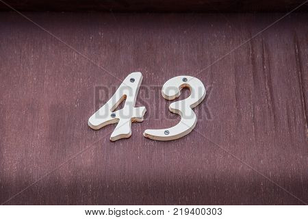 Number 43 (fourty three) on a wooden door