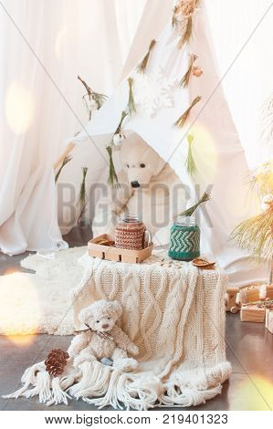 The idea of Christmas decoration for children. Wigwam with polar bears and cocoa.