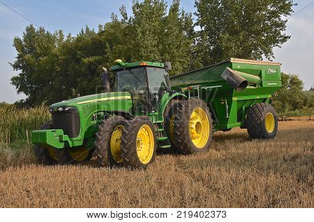 ROLLAG, MINNESOTA, Sept 1, 2017: A new 8420 John Deere tractor and grain cart are ready for demonstrations at the annual WCSTR farm show in Rollag held each Labor Day weekend where 1000's attend.