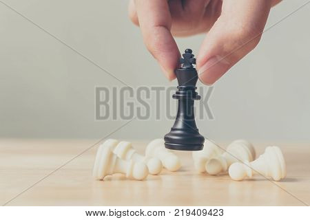 Plan leading strategy of successful business competition leader concept Hand of player chess board game putting black pawn Copy space for your text