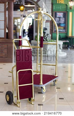 Luggage cart or hotel trolley in a luxury hotel on lobby zone