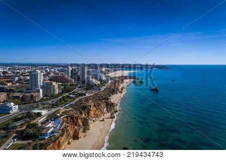 Aerial view of the coastline in Praia da Rocha in Portimao Algarve Portugal; Concept for travel in Portugal and Algarve