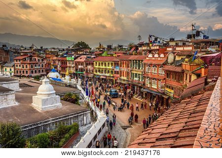 KATHMANDU, NEPAL - OCTOBER 28, 2015 : Tourists and nepalese people around Boudhanath  Stupa, one of the largest ancient stupa in the world.