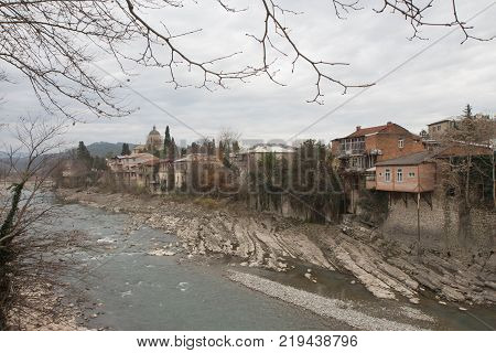 View on the river Rioni in Kutaisi. Rioni River with surrounding beaches Kutaisi Georgia. Old houses in Kutaisi on the banks of the Rioni River