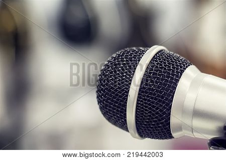 Silver microphone on blurred background voice mic entertainment song sound
