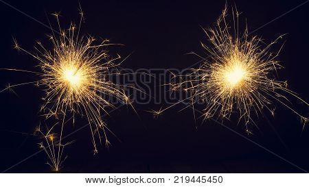 Christmas sparklers on a dark background. Copy of space. Holidays.