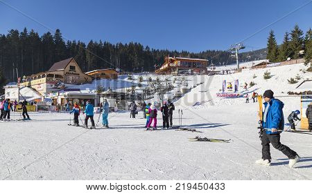 January 1 2017 . Ski park Kubinska Hola Slovakia. District Dolny Kubin near the border with Poland. New Year. Bright frosty holiday. People skiing go on chair lift. Concept of sport family rest healthy lifestyle.
