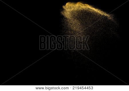 Yellow Sand Explosion Isolated On Black Background. Abstract Sand Cloud. Golden Colored  Sand Splash