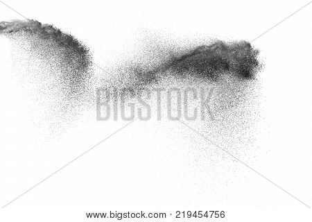 Black Sand Explosion Isolated On White Background. Abstract Sand Cloud. Black Sand Splash Agianst On