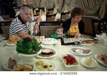 Portrait of a family in the restaurant