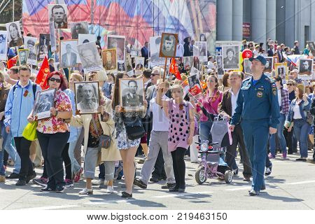 SAMARA RUSSIA - MAY 9 2017: Procession of the people in Immortal Regiment on annual Victory Day May 9 2017 in Samara Russia