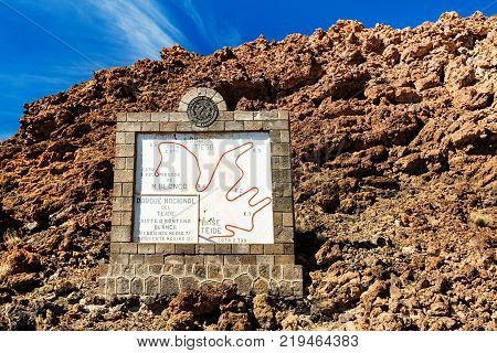 Teide National Park, Tenerife, Canary Islands - Tourist informational sign depicting the Montana Blanca hiking trail of the Teide volcano ascent, at 3718 m tall, it is the tallest peak in Spain