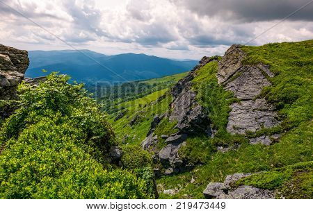 rocky cliff on the hillside edge. spectacular view of mountainous landscape