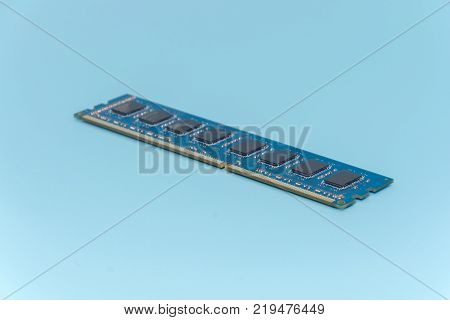 Stick of computer random access memory (RAM) on blue background