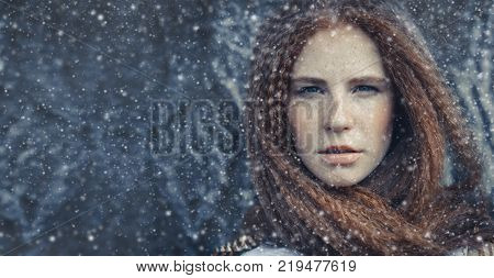 Beauty Christmas Fashion Model Girl Red Hair Freckles On Face, Portrait Drops Snow. Portrait Of A Yo