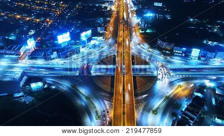 Aerial view Road roundabout Expressway with car lots in the city in Thailand.beautiful Street downtowncityscapeTop view. BackgroundAerial view city scape