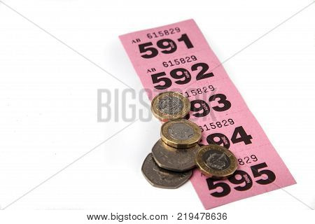 Pink Raffle Tickets With Uk Coins And Negative Space For Copy