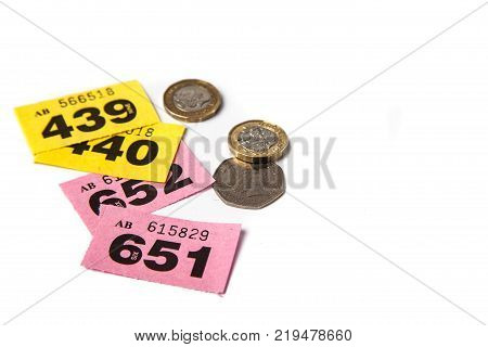 Pink and Yellow Raffle Tickets with UK coins and negative space for copy