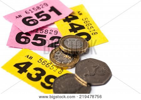 Yellow and Pink Raffle Tickets with UK Coins with negative space