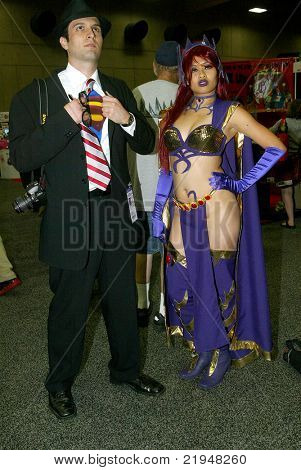 SAN DIEGO, CA - JULY 20: Two unidentified fans dress up in characters for the preview night at the 2011 Annual Comic Con International convention on July 20, 2011 in San Diego, CA