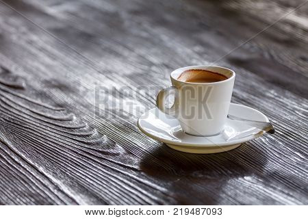 Invigorating morning cup of coffee on wooden table