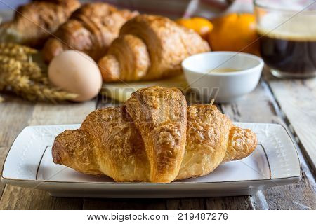 Continental breakfast with croissants, honey and coffee. Selective focus