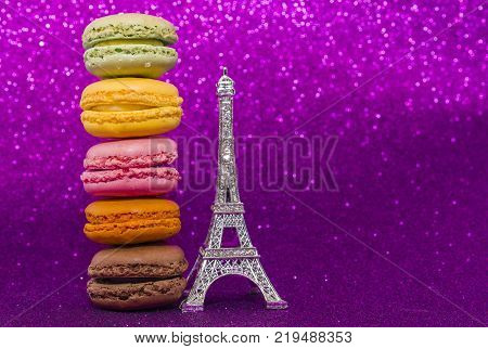 Top view of colorful macaron or macaroon on pink background. macaroon
