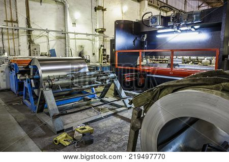 Metalworking factory interior with machinery equipment tools, industrial manufacturing of steel air conditioning pipes and systems, toned