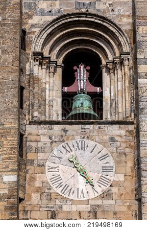 The bell and the clock on the Lisbon Cathedral's tower. The cathedral was originated in the 12th century and classified as a National Monument since 1910.