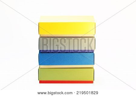 Few colorful paper boxes of colored cardboard for packing bow ties and other gifts on a white background. Hand made.