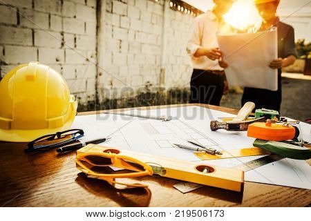 A desk of engineers who are studying the area for laying foundation of energy saving homes and raw material costs.
