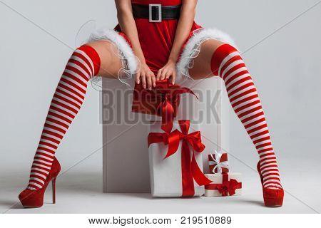 Sexy Santa woman legs and Christmas gifts