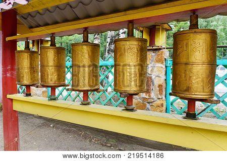 Prayer cylinders in Buddhist datsan Dechen Ravzhalin in Arshan. Buryatia. Russia