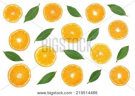 Slices of orange or tangerine with leaves isolated on white background. Flat lay, top view. Fruit composition.