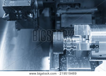 CNC lathe machine (Turning machine) cutting the metal screw thread part .Rotation of aluminium part.