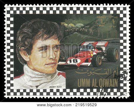 Umm al Quwain - circa 1972: Stamp printed by Umm al Quwain Color edition on Car Racing shows Racing driver Jacques Bernard Ickx from Belgium circa 1972