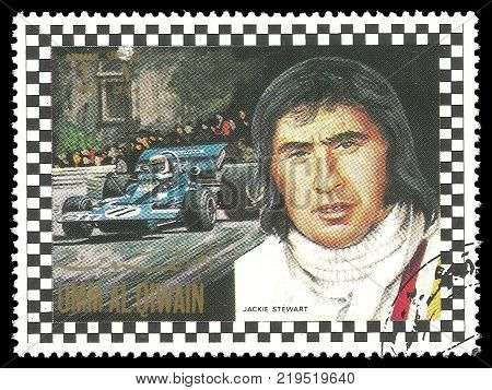 Umm al Quwain - circa 1972: Stamp printed by Umm al Quwain Color edition on Car Racing shows Racing driver John Young Stewart from Great Britain circa 1972