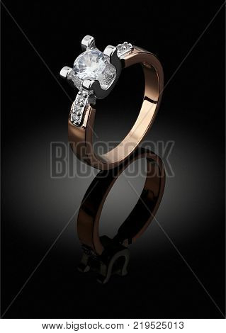 Golden Jewelery ring with big diamond on black background clipping path