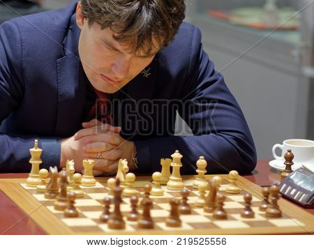 ST. PETERSBURG, RUSSIA - DECEMBER 4, 2017: Evgeny Romanov in the match against Nikita Vitiugov during super finals of 70th Russian men's chess championship. Vitiugov  won the match
