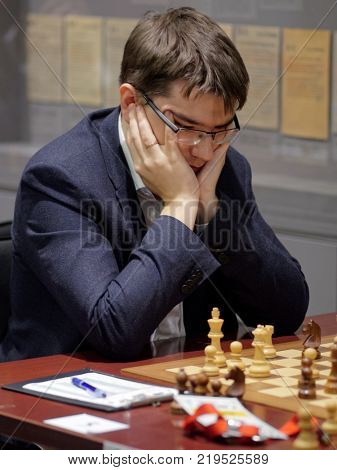 ST. PETERSBURG, RUSSIA - DECEMBER 4, 2017: Evgeny Tomashevsky in the match against Vladimir Fedoseev during super finals of 70th Russian men's chess championship. Fedoseev won the match