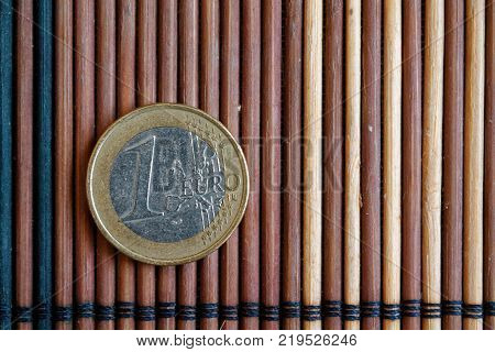 One Euro Coin Lie On Wooden Bamboo Table Denomination Is One Euro