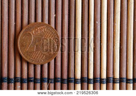 One Euro Coin Lie On Wooden Bamboo Table Denomination Is 2 Euro Cent